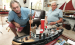 Model boat friends: Guy Clifford (left) and Brian Fulford, both career seafarers and friends for decades, check out a detailed, hand made scale remote control model of a tug boat at Fulford's waterside home in Fort Lauderdale.