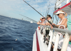 Ten women from Miami to Boca Raton fish off the back of the starboard side of Catch My Drift party boat April 19 a few miles from Fort Lauderdale beach.