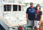 Scott and Anita McIlvaine pose in front of their 43-foot Post sport fisherman. They live in Pompano Beach and will participate in three boat parades: Pompano Beach, Boca Raton, and Seminole Hard Rock Winterfest.